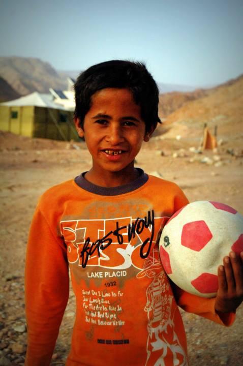 Playing football in the Dana Biosphere in Jordan - by photographer Kristen Gill