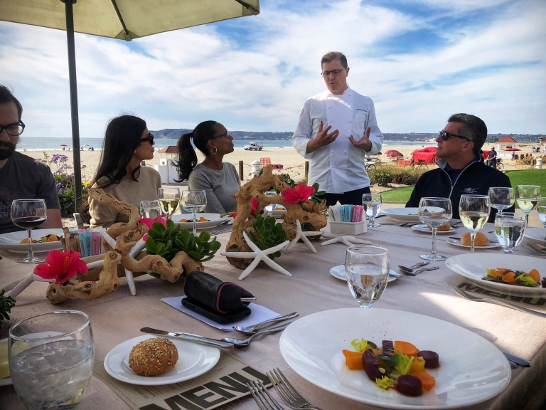 Executive Chef Stefan Peroutka explains his meal concept at Hotel del Coronado's outdoor setting. - Copyright Kristen Gill Media 2018